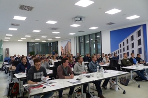 """<div class=""""bildtext""""><span class=""""bildnummer"""">»3</span> More than 40 students, postgraduates and their tutors took in the specialists' lectures on the topic of clay bricks</div>"""