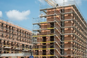 """<div class=""""bildtext""""><span class=""""bildnummer"""">»2 </span>The construction industry is faced with the challenge of linking centuries-old building traditions with digital processes, as digitalization increases <br />productivity, reduces costs and enables on-schedule completion of projects</div>"""