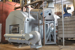"<div class=""bildtext""><span class=""bildnummer"">»1</span> Example of a Puls+GB heat generation system at a brick plant in Bosnia. A hammer mill installed below the conveyor crushes the fuel pellets to enable their pneumatic handling</div>"
