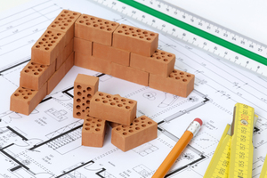 "<div class=""bildtext""><span class=""bildnummer"">»3 </span>The brick masonry as a construction material can master the balancing act between individualization and Prefab 2.0</div>"
