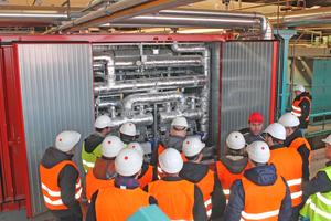 """<div class=""""bildtext""""><span class=""""bildnummer"""">»1</span> Im Wienerberger-Werk Uttendorf, Österreich, beheizt die neue Hochtemperatur-Wärmepumpe einen Teilbereich des Tunneltrockners</div>"""