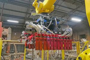 """<div class=""""bildtext""""><span class=""""bildnummer"""">»2</span> New robot setting gripper for Northcot Brick, UK</div>"""