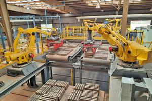 """<div class=""""bildtext_en""""><span class=""""bildnummer"""">»</span> Other equipment was renewed, such as two gripper robots.</div>"""