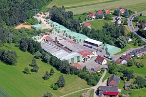 "<div class=""bildtext_en"">»2 Aerial photo of the Ott brick factory</div>"