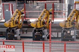 """<span class=""""bildunterschrift_hervorgehoben"""">»2</span> In the Heluz brick plant, cut wet bricks are set on pallets by robots"""