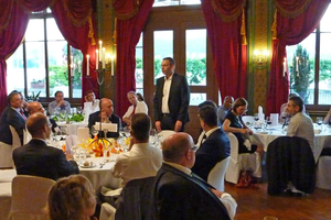 """<div class=""""bildtext_en""""><span class=""""textmarkierung"""">»4</span> TBE President Ioannis Maliouris (standing) thanked the Swiss organizers for a perfectly crafted event</div>"""