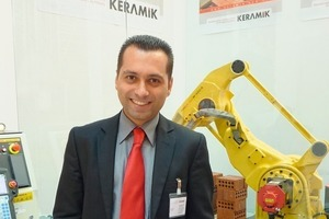"<span class=""bildunterschrift_hervorgehoben"">»1</span> Omer Tuncay, Sales Manager at Keramik Makina San. Tic. Ve Taah. Ltd. Sti., Turkey, pictured in front of an unloading robot<br />"