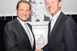 """<span class=""""bildunterschrift_hervorgehoben"""">»</span> Alfons Hörmann (left) hands over the reins of Creaton AG to Stephan Führling<br />"""