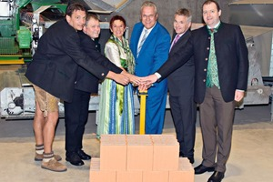 """<div class=""""bildtext_en""""><span class=""""textmarkierung"""">»1 </span>The Bavarian Minister of the Interior Joachim Herrmann together with honorary guests and members of the management, was the first to switch onthe new plant. In the photo from left: Heinz Girgner, Plant Manager at Zeilarn; Mayor Walter Lechl; Reserl Sem, Member of the Bavarian State Parliament; Joachim Herrmann; Johannes Edmüller, Managing Partner, and Michael Fahmüller, District Administrator for Rottal-Inn</div>"""