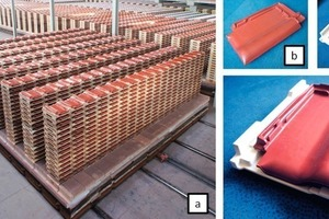 """<div class=""""bildtext_en""""><span class=""""bildnummer"""">»1</span> Roof-tile production: (a) stack of goods on tunnel kiln cars, (b) roof tile with crank (single cell), (c)crank, (d) roof tile with crank (single cell)</div>"""